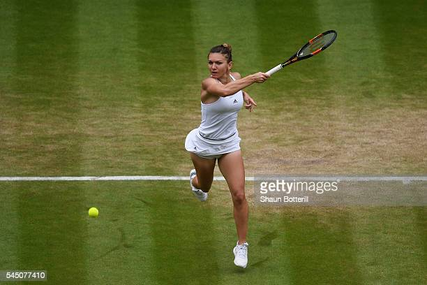 Simona Halep of Romania plays a forehand during the Ladies Singles Quarter Finals match against Angelique Kerber of Germany on day eight of the...