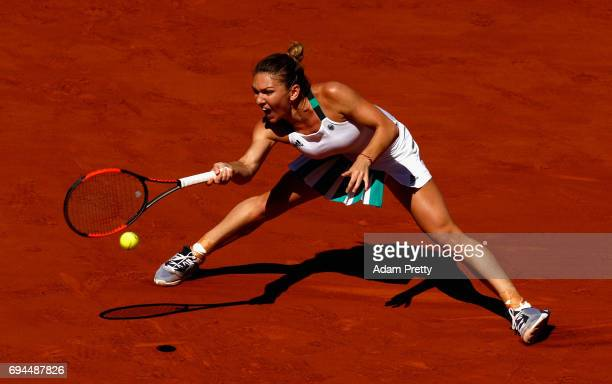 Simona Halep of Romania plays a forehand during the ladies singles final match against Jelena Ostapenko of Latvia on day fourteen of the 2017 French...