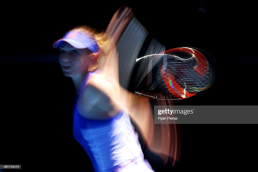 Simona Halep of Romania plays a forehand in her first round match against Karin Knapp of Italy during day one of the 2015 Australian Open at...