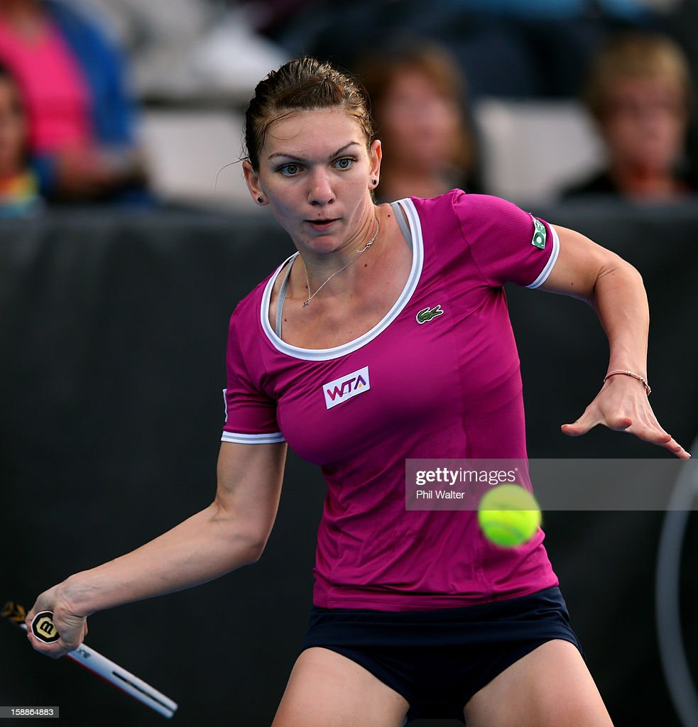 Simona Halep of Romania plays a forehand in her second round match against Agnieszka Radwanska of Poland during day three of the 2013 ASB Classic on January 2, 2013 in Auckland, New Zealand.