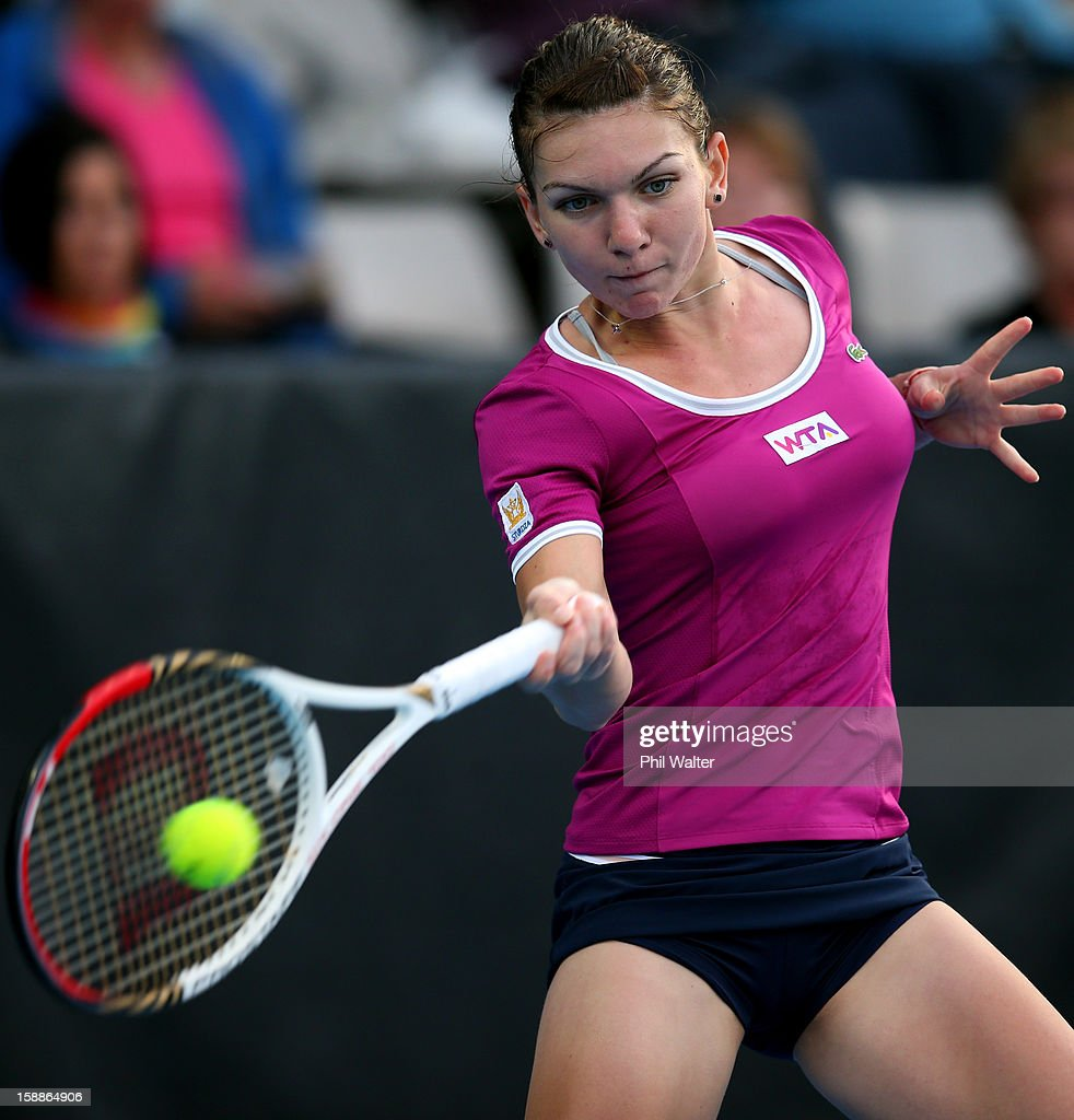 <a gi-track='captionPersonalityLinkClicked' href=/galleries/search?phrase=Simona+Halep&family=editorial&specificpeople=4835837 ng-click='$event.stopPropagation()'>Simona Halep</a> of Romania plays a forehand in her second round match against Agnieszka Radwanska of Poland during day three of the 2013 ASB Classic on January 2, 2013 in Auckland, New Zealand.