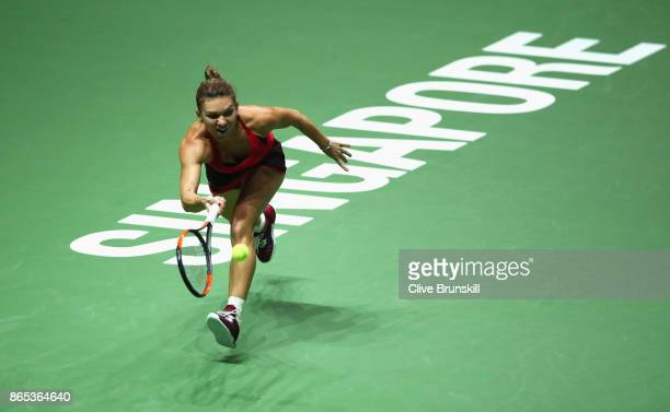 Simona Halep of Romania plays a forehand in her singles match against Caroline Garcia of France during day 2 of the BNP Paribas WTA Finals Singapore...