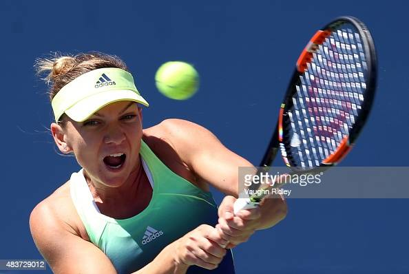 Simona Halep of Romania plays a shot against Jelena Jankovic of Serbia during Day 3 of the Rogers Cup at the Aviva Centre on August 12 2015 in...