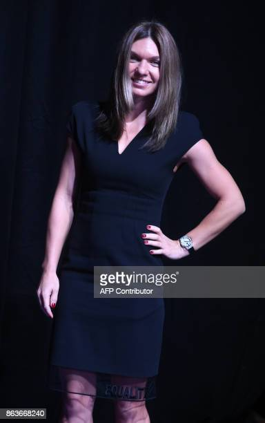 Simona Halep of Romania poses for photographers duirng the Official Draw Ceremony of the WTA Finals Singapore on October 20 2017 The WTA Finals...