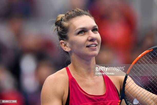 Simona Halep of Romania reacts as she becomes world number one of the WTA rankings after her WomenÕs single semifinal match against Jelena Ostapenko...