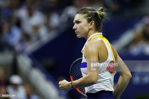 Simona Halep of Romania reacts during her first round Women's Singles match against Maria Sharapova of Russia on Day One of the 2017 US Open at the...