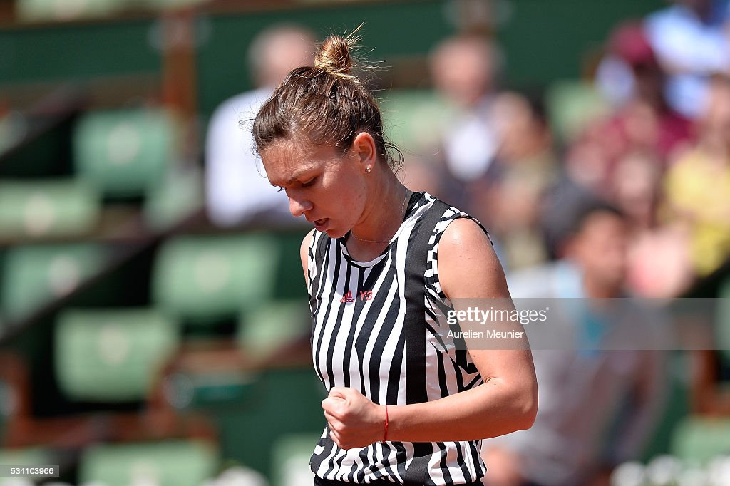 <a gi-track='captionPersonalityLinkClicked' href=/galleries/search?phrase=Simona+Halep&family=editorial&specificpeople=4835837 ng-click='$event.stopPropagation()'>Simona Halep</a> of Romania reacts during her women's single second round match against Zarina Diyas of Kazakhstan on day four of the 2016 French Open at Roland Garros on May 25, 2016 in Paris, France.