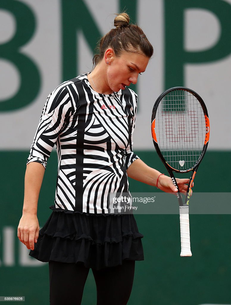 <a gi-track='captionPersonalityLinkClicked' href=/galleries/search?phrase=Simona+Halep&family=editorial&specificpeople=4835837 ng-click='$event.stopPropagation()'>Simona Halep</a> of Romania reacts during the Ladies Singles fourth round match against Samantha Stosur of Australia on day ten of the 2016 French Open at Roland Garros on May 31, 2016 in Paris, France.