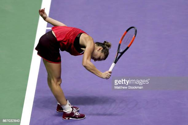 Simona Halep of Romania reacts in her singles match against Elina Svitolina of Ukraine during day 6 of the BNP Paribas WTA Finals Singapore presented...