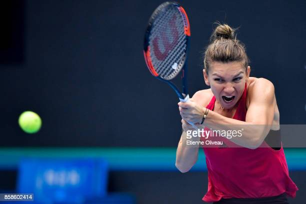 Simona Halep of Romania returns a shot against Jelena Ostapenko of Latvia during her WomenÕs single semifinal match on day eight of the 2017 China...