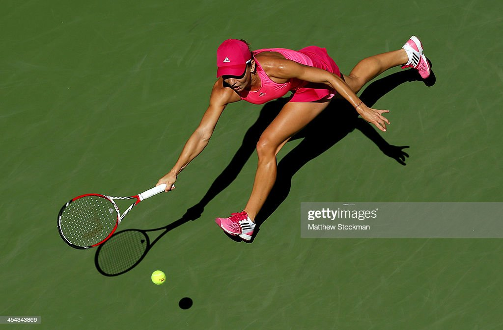 Simona Halep of Romania returns a shot against Mirjana Lucic of Croatia during their women's singles third round match on Day Five of the 2014 US...