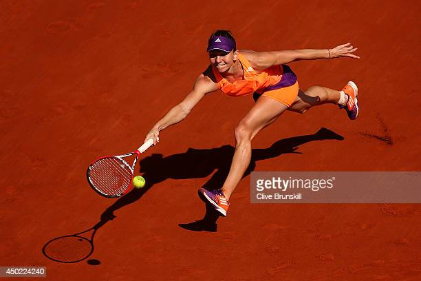 Simona Halep of Romania returns a shot during her women's singles final match against Maria Sharapova of Russia on day fourteen of the French Open at...