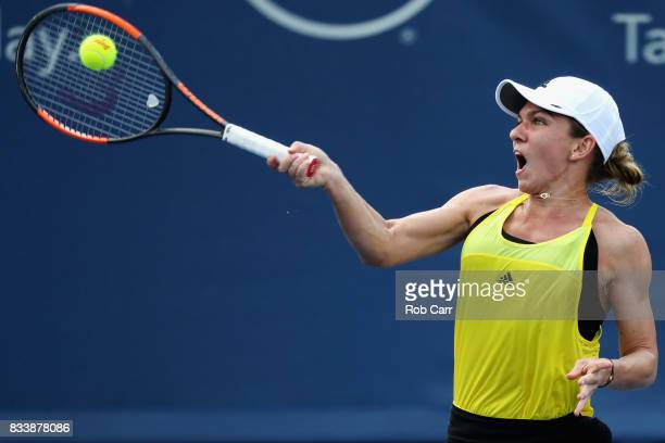 Simona Halep of Romania returns a shot to Anastasija Sevastova of Latvia during Day 6 of the Western and Southern Open at the Linder Family Tennis...