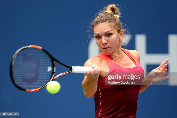 Simona Halep of Romania returns a shot to Flavia Pennetta of Italy during their Women's Singles Semifinals match on Day Twelve of the 2015 US Open at...