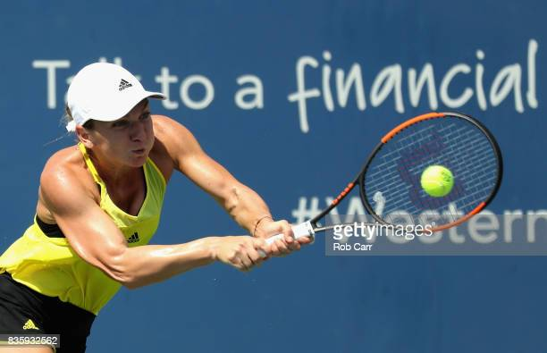 Simona Halep of Romania returns a shot to Garbine Muguruza of Spain during Day 9 of the women's final of the Western and Southern Open at the Linder...