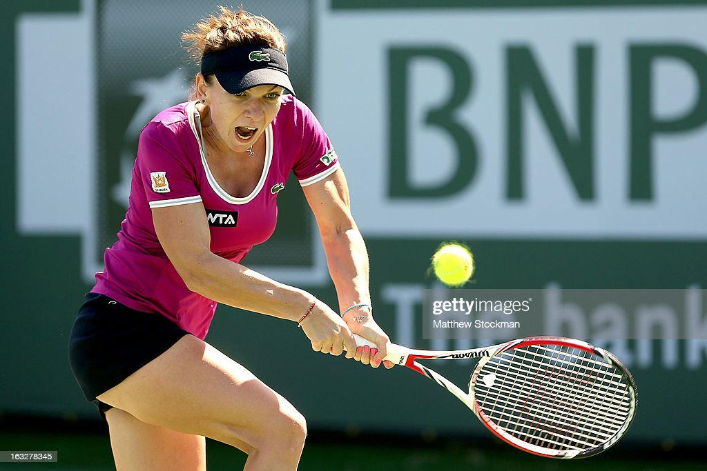 <a gi-track='captionPersonalityLinkClicked' href=/galleries/search?phrase=Simona+Halep&family=editorial&specificpeople=4835837 ng-click='$event.stopPropagation()'>Simona Halep</a> of Romania returns a shot to Lauren Davis during the BNP Paribas Open at the Indian Wells Tennis Garden on March 6, 2013 in Indian Wells, California.