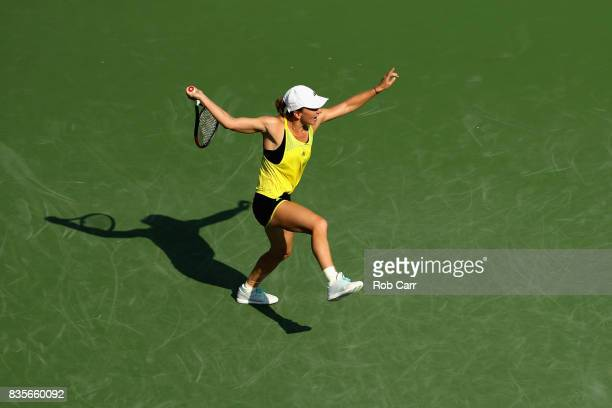 Simona Halep of Romania returns a shot to Sloane Stephens during Day 8 of the Western and Southern Open at the Linder Family Tennis Center on August...