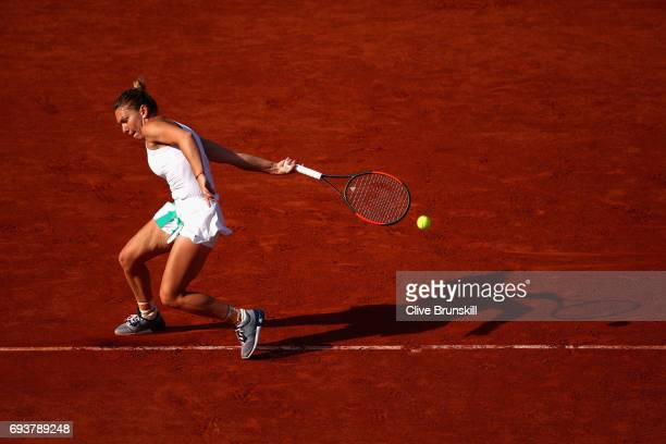 Simona Halep of Romania returns the ball during ladies singles semifinal match against Karolina Pliskova of The Czech Republic on day twelve of the...