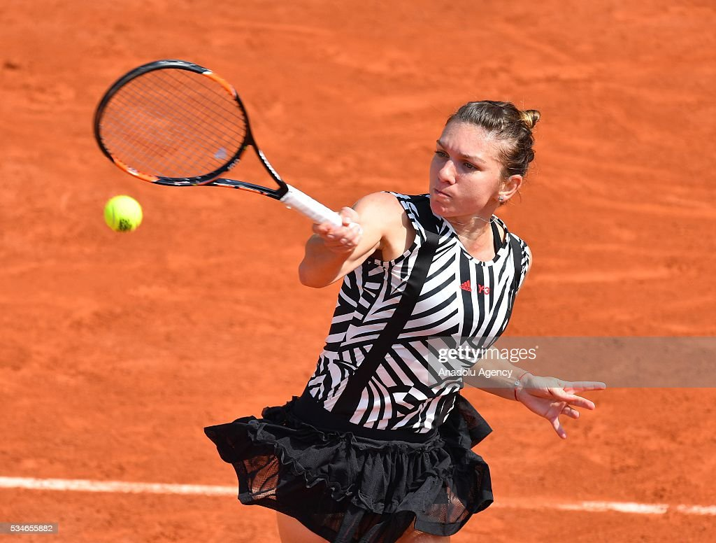 Simona Halep of Romania returns to Naomi Osaka (not seen) of Japan during women's single third round match at the French Open tennis tournament at Roland Garros Stadium in Paris, France on May 27, 2016.