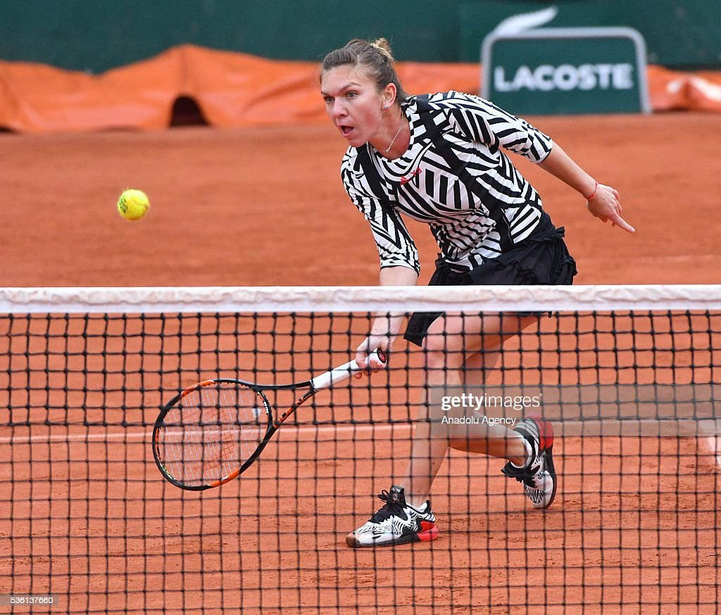 Simona Halep (C) of Romania returns to Samantha Stosur (not seen) of Australia during the women's single fourth round match at the French Open tennis tournament at Roland Garros Stadium in Paris, France on May 30, 2016.