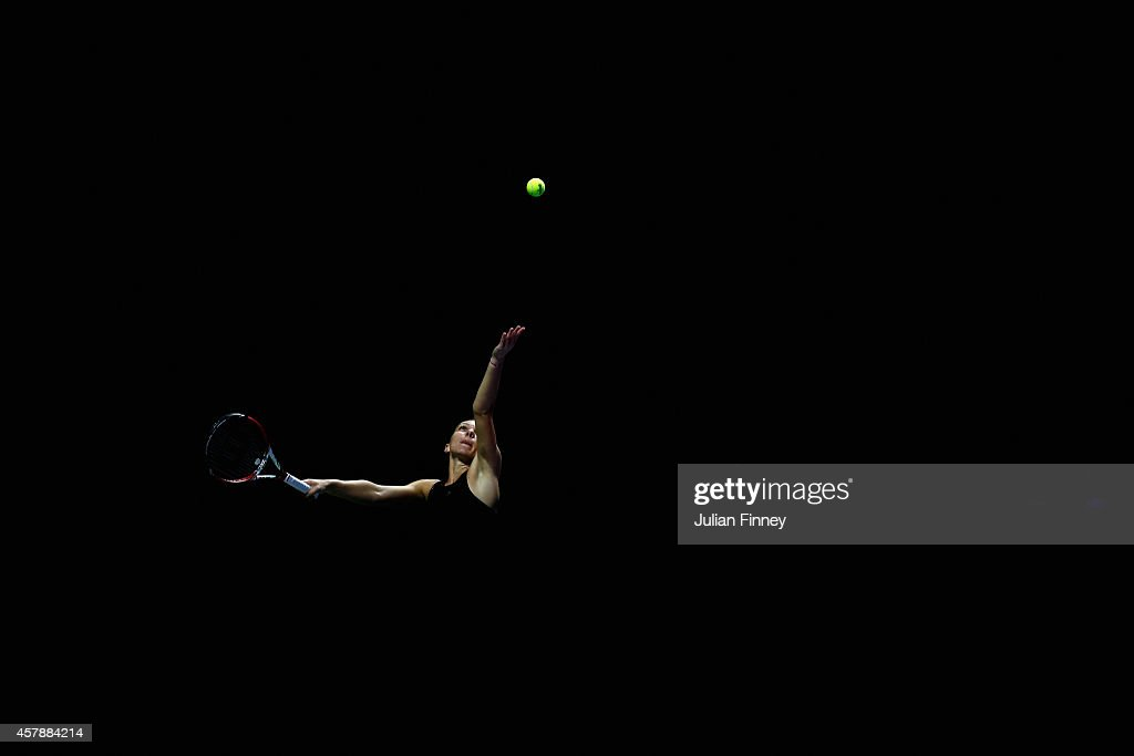 Simona Halep of Romania serves against Serena Williams of USA in the final during day seven of the BNP Paribas WTA Finals tennis at the Singapore...