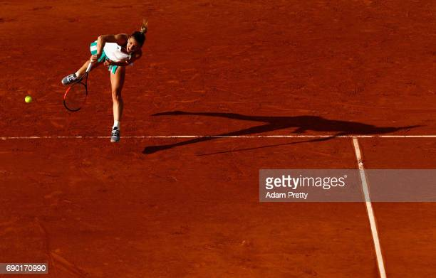 Simona Halep of Romania serves during the ladies singles first round match against Jana Cepelova of Slovakia on day three of the 2017 French Open at...