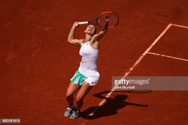 Simona Halep of Romania serves during the ladies singles fourth round match against Carla Suarez Navarro of Spain on day nine of the 2017 French Open...