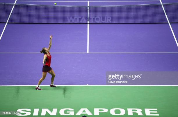 Simona Halep of Romania serves in her singles match against Caroline Garcia of France during day 2 of the BNP Paribas WTA Finals Singapore presented...