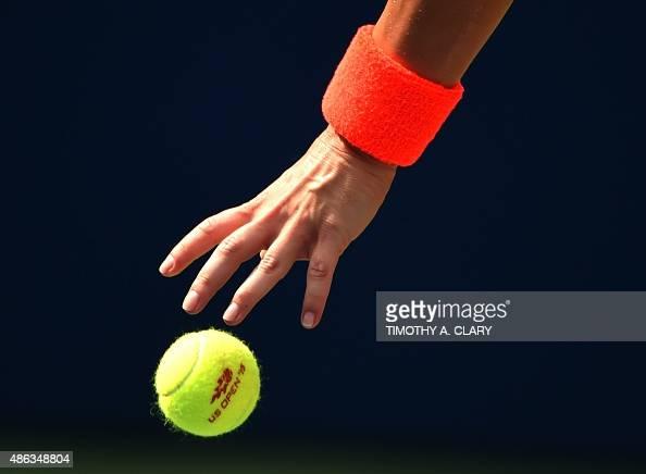 Simona Halep of Romania serves the ball against Kateryna Bondarenko of Ukraine during the 2015 US Open women's singles round two match at the USTA...