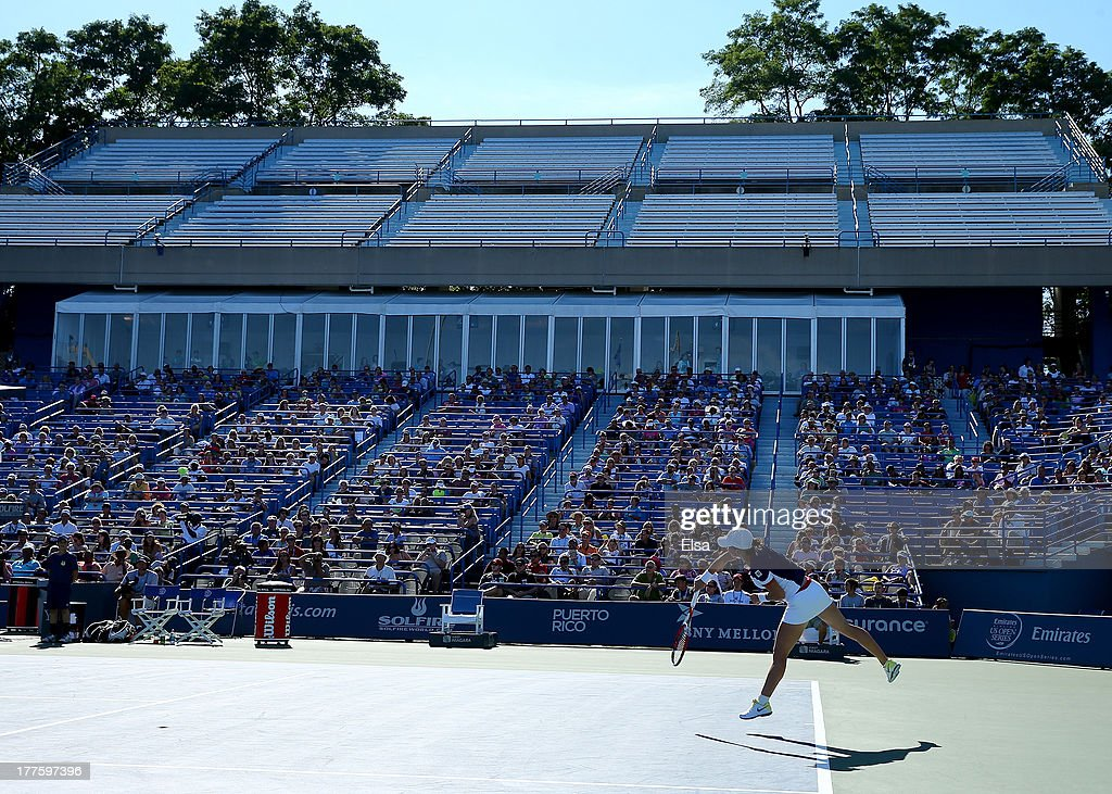 Simona Halep of Romania serves the ball to Petra Kvitova of the Czech Republic during the Women's Final on Day Seven of the New Haven Open at Yale at...