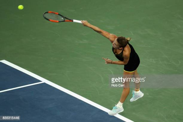 Simona Halep of Romania serves to Johanna Konta of Great Britain during Day 7 of the Western and Southern Open at the Linder Family Tennis Center on...