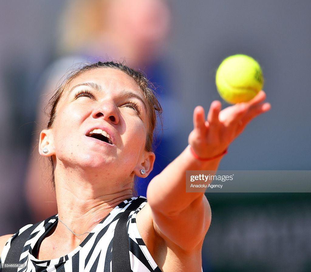 Simona Halep of Romania serves to Naomi Osaka (not seen) of Japan during women's single third round match at the French Open tennis tournament at Roland Garros Stadium in Paris, France on May 27, 2016.