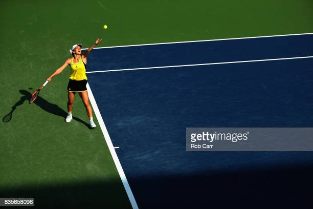 Simona Halep of Romania serves to Sloane Stephens during Day 8 of the Western and Southern Open at the Linder Family Tennis Center on August 19 2017...