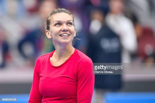 Simona Halep of Romania smiles as she becomes world number one of the WTA rankings after her Women's single semifinal match against Jelena Ostapenko...