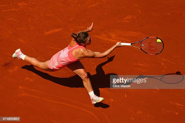 Simona Halep of Romania stretches for a forehand in her Women's Singles match against Mirjana LucicBaroni of Croatia during day four of the 2015...