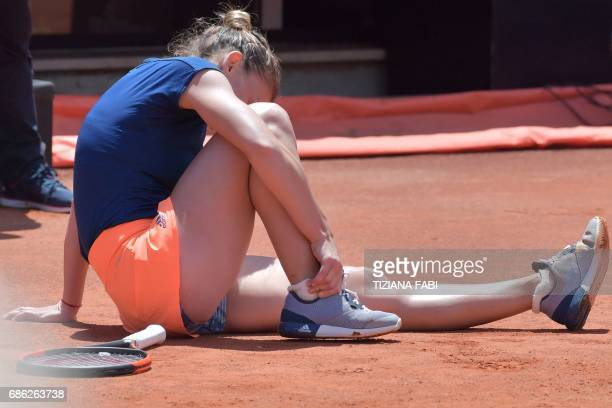 Simona Halep of Romania touches her foot seated on the ground during the WTA Tennis Open final against Elina Svitolina of Ukraineat the Foro Italico...