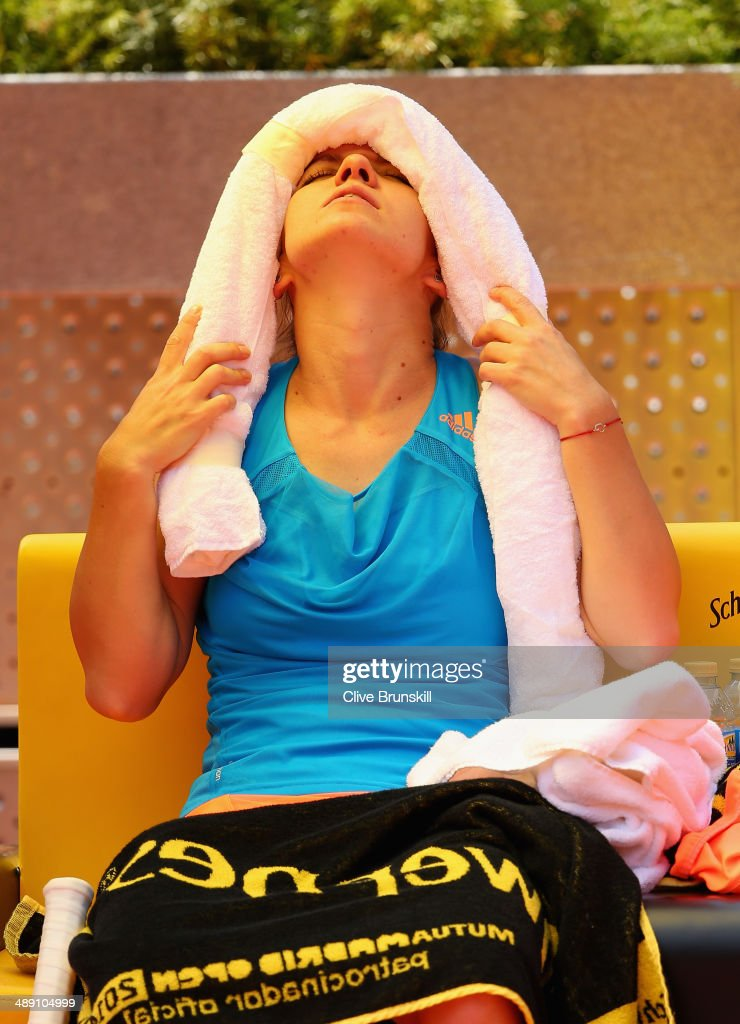 Simona Halep of Romania tries to cool down during the change over against Petra Kvitova of the Czech Republic in their semi final match during day eight of the Mutua Madrid Open tennis tournament at the Caja Magica on May 10, 2014 in Madrid, Spain.