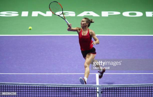 Simona Halep of Romania volleys in her singles match against Caroline Garcia of France during day 2 of the BNP Paribas WTA Finals Singapore presented...