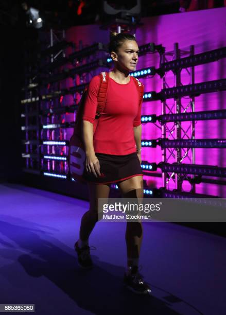 Simona Halep of Romania walks out in her singles match against Caroline Garcia of France during day 2 of the BNP Paribas WTA Finals Singapore...