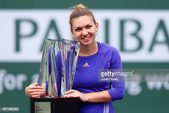 Simona Halep of Romania with the winners trophy after defeating Jelena Jankovic of Serbia in the final during day fourteen of the BNP Paribas Open...