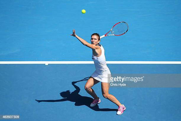 Simona Halep of Romaniaplays a forehand in her fourth round match against Jelena Jankovic of Serbia during day eight of the 2014 Australian Open at...