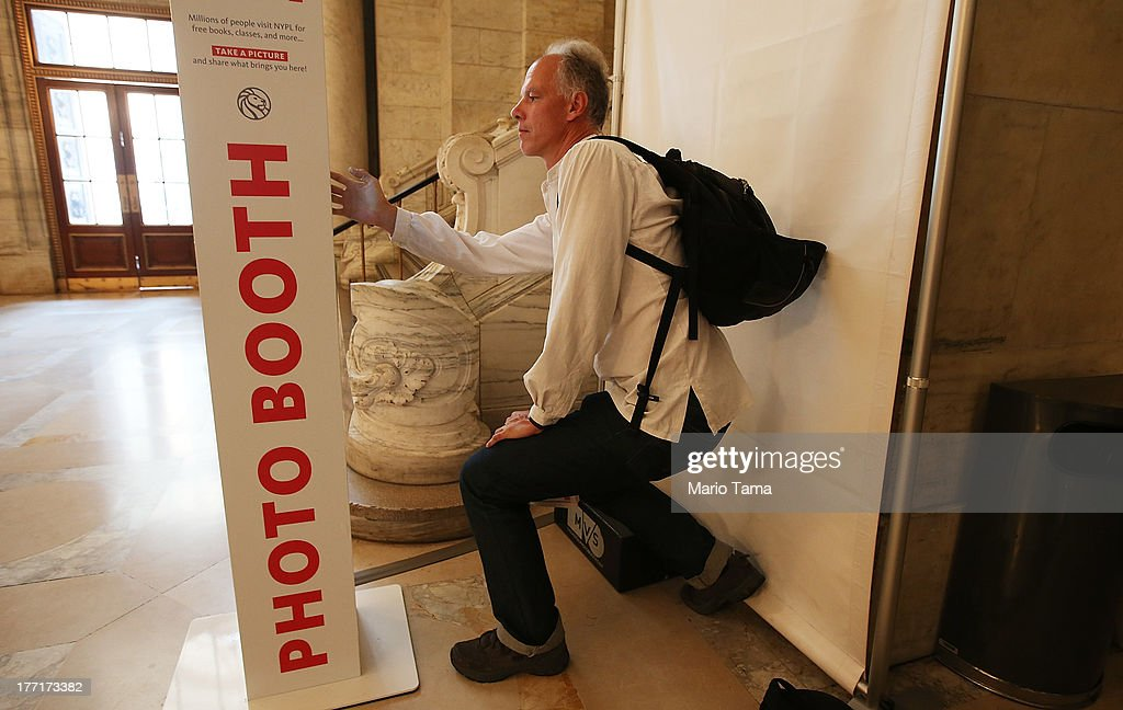 Simonas Zmuidzinas takes a 'selfie' at a new photobooth in the New York Public Library on August 21, 2013 in New York City. Visitors are invited to take pictures of themselves in the library which will be placed on the library's website and also emailed to the user.