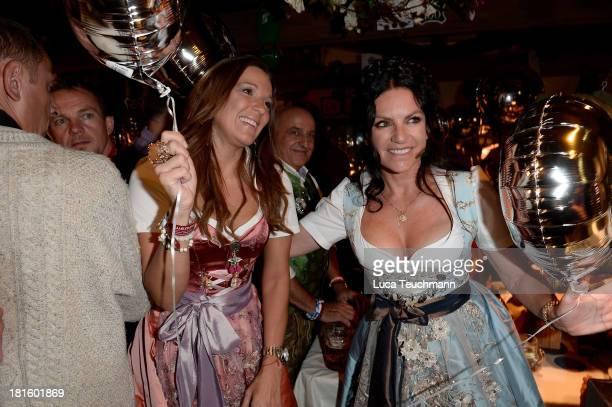 Simone Ballack and Christine Neubauer attend the 'Almauftrieb' as part of the Oktoberfest beer festival at Kaefer tent at Theresienwiese on September...