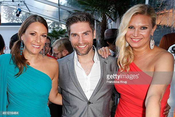 Simone Ballack Christian Polanc and Magdalena Brzeska attend the Raffaello Summer Day 2014 on June 21 2014 in Berlin Germany