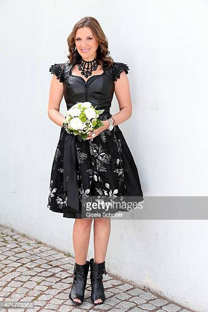 Simone Ballack wearing a dirndl by Astrid Soell hair accesssoires by 'Schoenmich' jewellery by 'sweet deluxe' poses during a photo session on May 11...