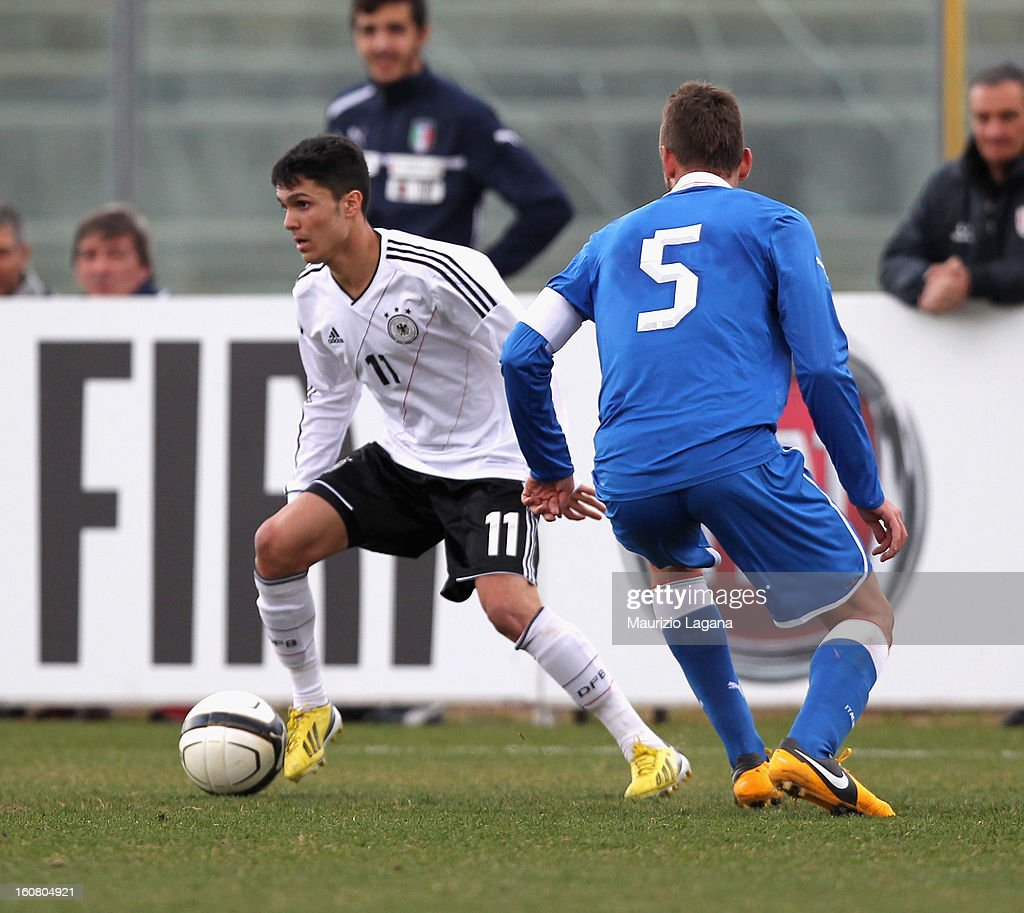 Simone Benedetti (R) of Italy competes for the ball with Leonardo Bittencourt of Germany during U20 International Friendly match between Italy and Germany at Stadio Cosimo Puttilli on February 6, 2013 in Barletta, Italy.