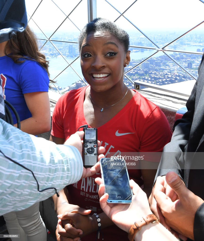 Simone Biles a member of the 'Final Five' US Women's Gymnastics Olympic Team speaks to the media during a visit to the Empire State Building in New...