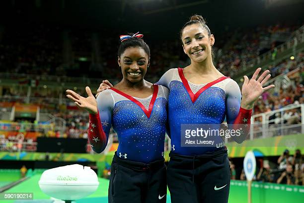 Simone Biles and Alexandra Raisman of the United States pose for photographs after winning the gold and silver medals respectively after competing on...