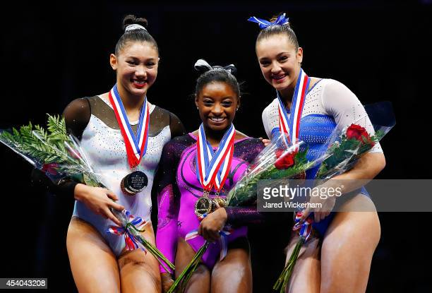 Simone Biles Kyla Ross and Maggie Nichols pose for a photo on the podium after accepting their medals in the senior women finals during the 2014 PG...