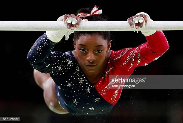 Simone Biles of the United States competes on the uneven bars during Women's qualification for Artistic Gymnastics on Day 2 of the Rio 2016 Olympic...
